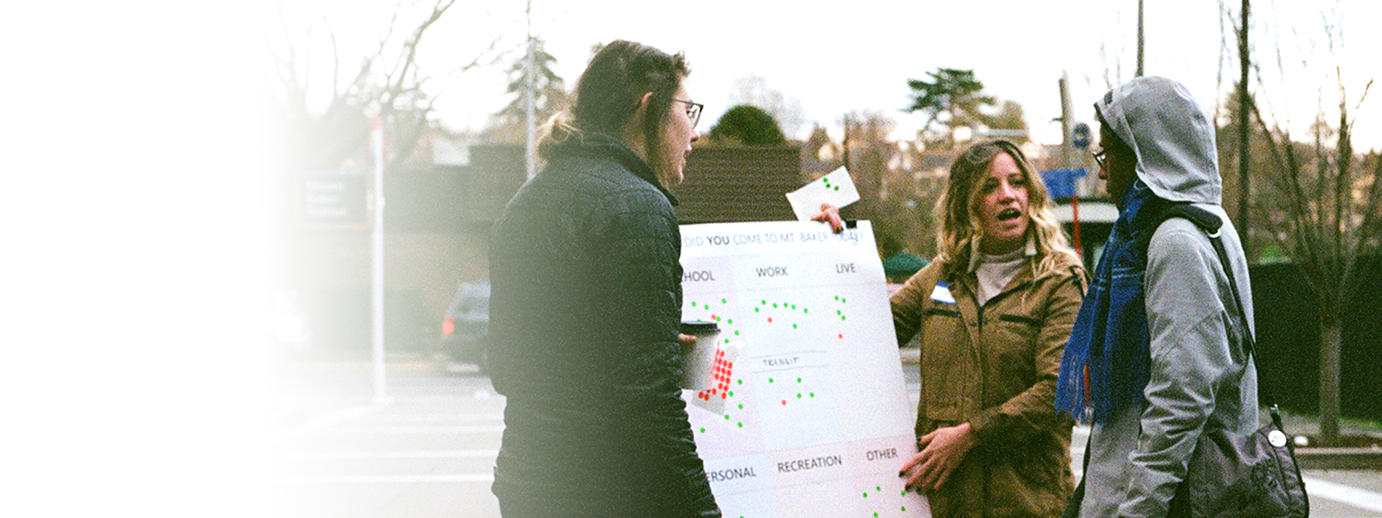 Students engaging with people at the Mt Baker Transit Station
