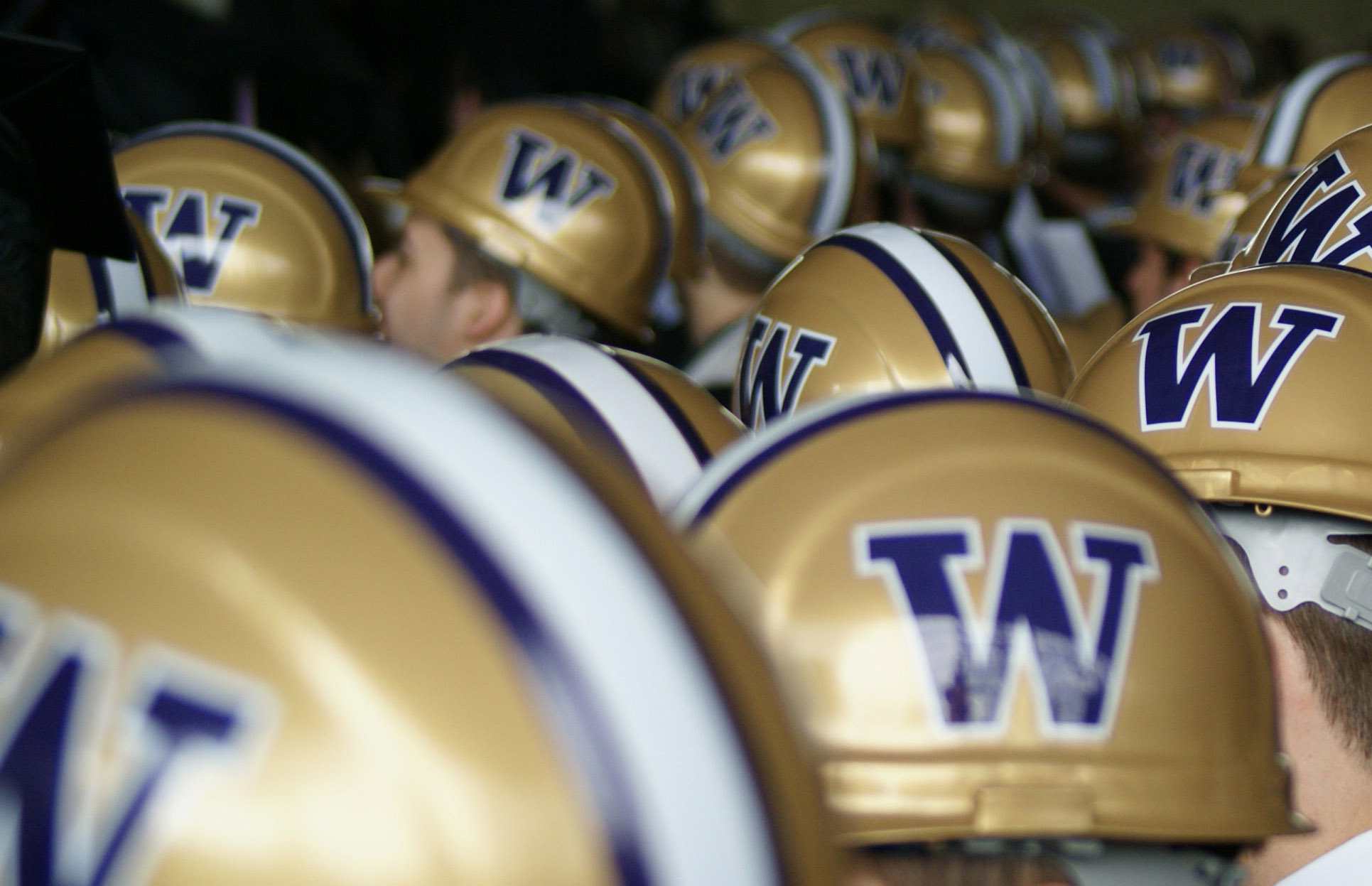 Construction helmets with the UW logo on the side
