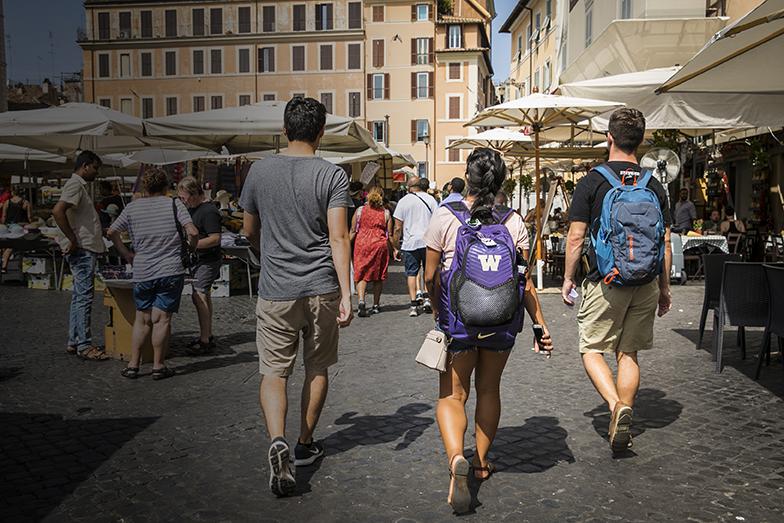 Students in Rome walking toward a market