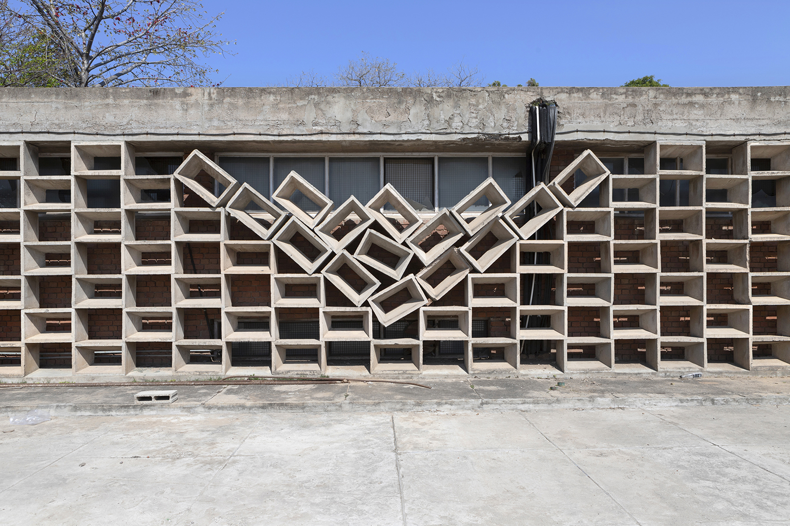 Exterior of a building with stacked concrete blocks and the middle in the shape of a V